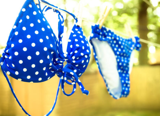 Retro toned polka dot bikini on clothesline