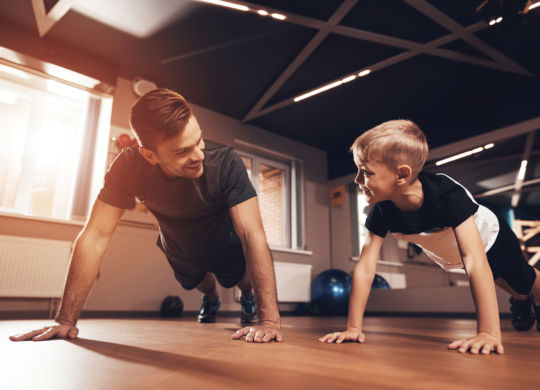 3060247 Father and son in the gym. Father and son spend time tog